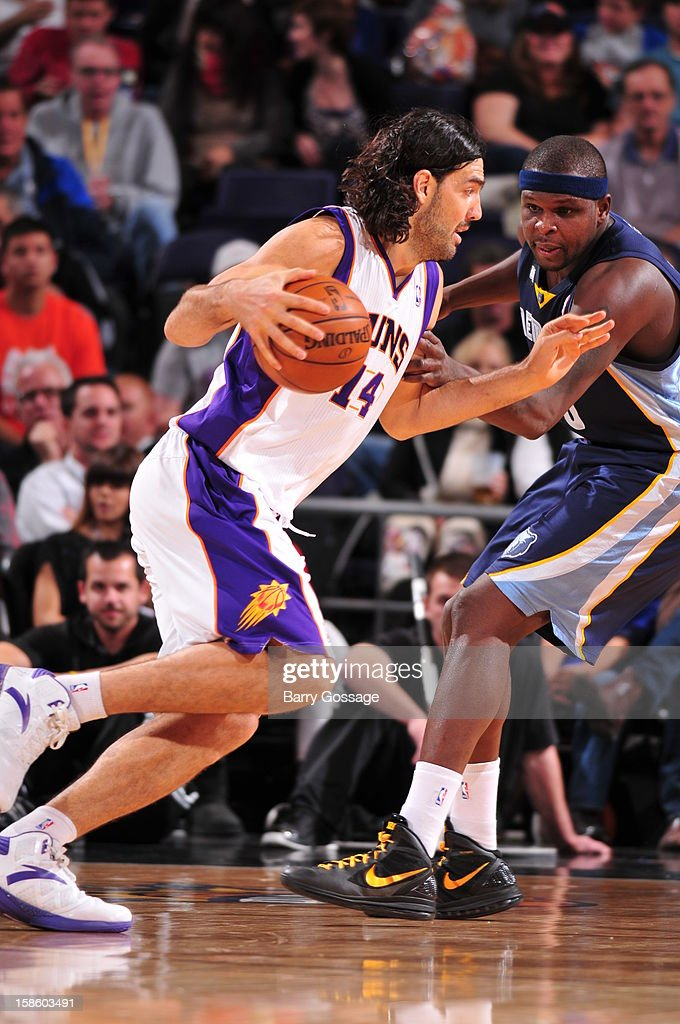 <a gi-track='captionPersonalityLinkClicked' href=/galleries/search?phrase=Luis+Scola&family=editorial&specificpeople=2464749 ng-click='$event.stopPropagation()'>Luis Scola</a> #14 of the Phoenix Suns drives to the basket around <a gi-track='captionPersonalityLinkClicked' href=/galleries/search?phrase=Zach+Randolph&family=editorial&specificpeople=201595 ng-click='$event.stopPropagation()'>Zach Randolph</a> #50 of the Memphis Grizzlies on December 12, 2012 at U.S. Airways Center in Phoenix, Arizona.