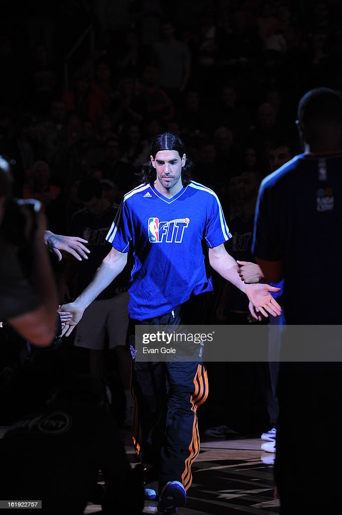 Luis Scola #14 of the Phoenix Suns enters the court during opening announcements before the game against the Los Angeles Clippers at US Airways Center on January 24, 2013 in Phoenix, Arizona.