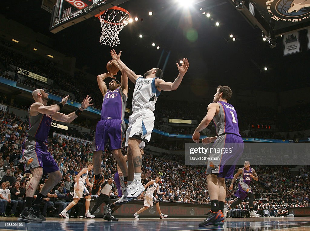 <a gi-track='captionPersonalityLinkClicked' href=/galleries/search?phrase=Luis+Scola&family=editorial&specificpeople=2464749 ng-click='$event.stopPropagation()'>Luis Scola</a> #14 of the Phoenix Suns gpes to the basket against <a gi-track='captionPersonalityLinkClicked' href=/galleries/search?phrase=Nikola+Pekovic&family=editorial&specificpeople=829137 ng-click='$event.stopPropagation()'>Nikola Pekovic</a> #14 of the Minnesota Timberwolves during the game between the Minnesota Timberwolves and the Phoenix Suns during the game on December 29, 2012 at Target Center in Minneapolis, Minnesota.