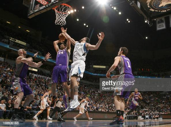 Luis Scola of the Phoenix Suns gpes to the basket against Nikola Pekovic of the Minnesota Timberwolves during the game between the Minnesota...