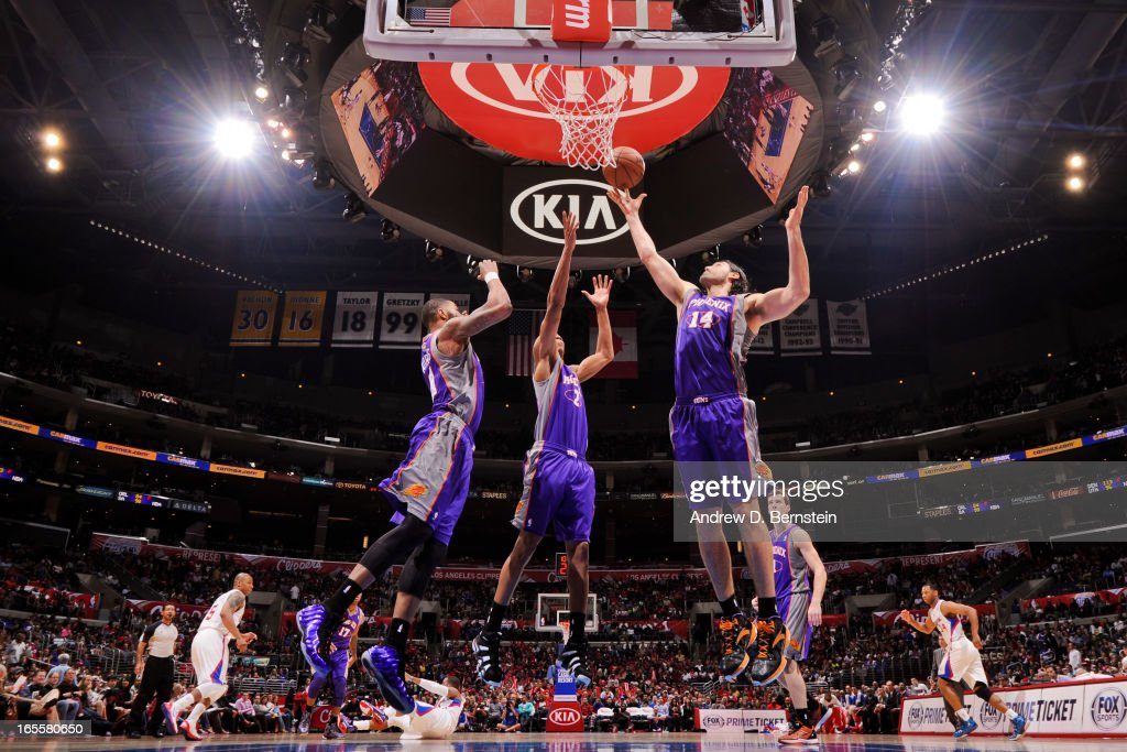 Luis Scola #14 of the Phoenix Suns grabs a rebound against the Los Angeles Clippers at Staples Center on April 3, 2013 in Los Angeles, California.
