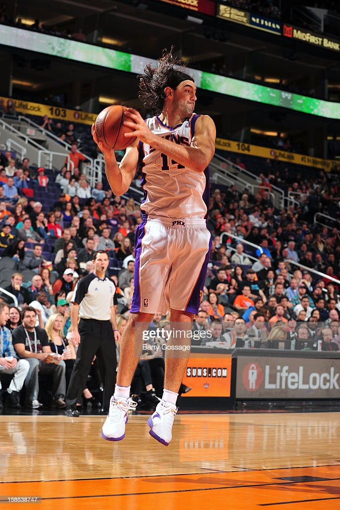 <a gi-track='captionPersonalityLinkClicked' href=/galleries/search?phrase=Luis+Scola&family=editorial&specificpeople=2464749 ng-click='$event.stopPropagation()'>Luis Scola</a> #14 of the Phoenix Suns grabs a rebound against the Sacramento Kings on December 17, 2012 at U.S. Airways Center in Phoenix, Arizona.