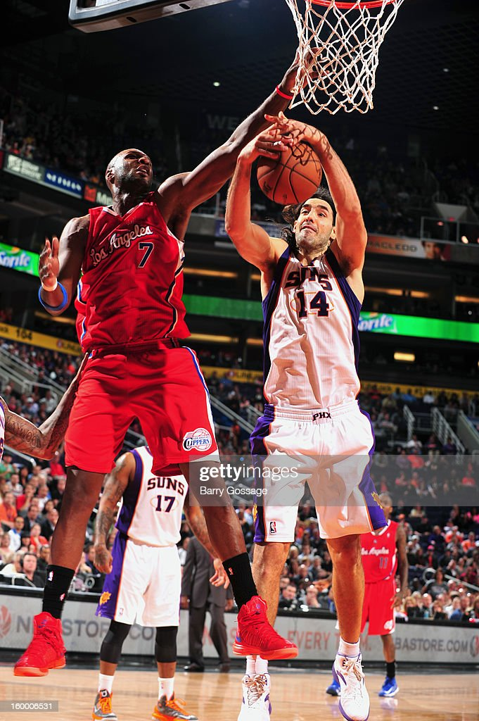 Luis Scola #14 of the Phoenix Suns grabs a rebound from Lamar Odom #7 of the Los Angeles Clippers on January 24, 2013 at U.S. Airways Center in Phoenix, Arizona.