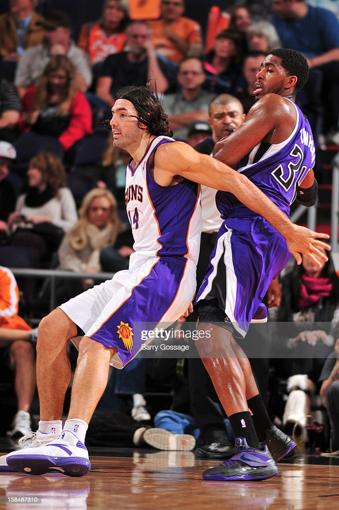 Luis Scola #14 of the Phoenix Suns guards Jason Thompson #34 of the Sacramento Kings on December 17, 2012 at U.S. Airways Center in Phoenix, Arizona.