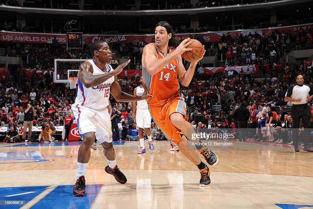 <a gi-track='captionPersonalityLinkClicked' href=/galleries/search?phrase=Luis+Scola&family=editorial&specificpeople=2464749 ng-click='$event.stopPropagation()'>Luis Scola</a> #14 of the Phoenix Suns handles the ball against <a gi-track='captionPersonalityLinkClicked' href=/galleries/search?phrase=Eric+Bledsoe&family=editorial&specificpeople=6480906 ng-click='$event.stopPropagation()'>Eric Bledsoe</a> #12 of the Los Angeles Clippers at Staples Center on December 8, 2012 in Los Angeles, California.