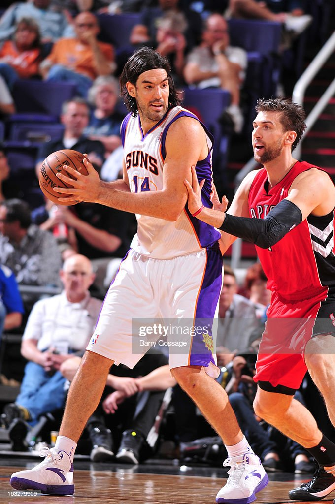 Luis Scola #14 of the Phoenix Suns is guarded by Andrea Bargnani #7 of the Toronto Raptors on March 6, 2013 at U.S. Airways Center in Phoenix, Arizona.