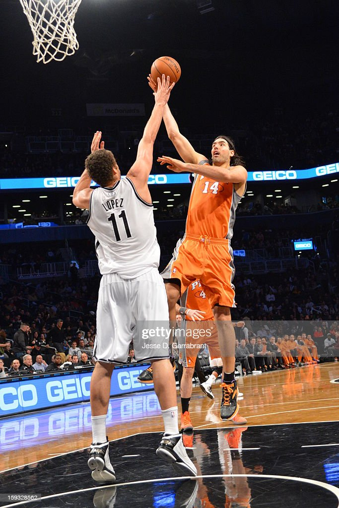Luis Scola #14 of the Phoenix Suns lays-up against Brook Lopez #11 of the Brooklyn Nets during the game at the Barclays Center on January 11, 2013 in Brooklyn, New York.