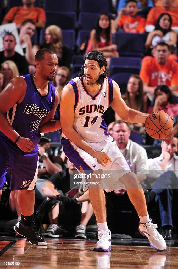 Luis Scola #14 of the Phoenix Suns looks for a pass around Chuck Hayes #42 of the Sacramento Kings on March 28, 2013 at U.S. Airways Center in Phoenix, Arizona.