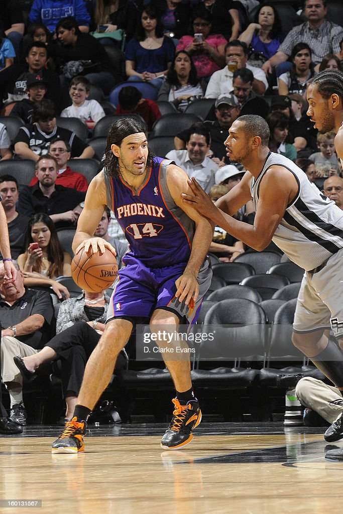 Luis Scola #14 of the Phoenix Suns posts up against Boris Diaw #33 of the San Antonio Spurs on January 26, 2013 at the AT&T Center in San Antonio, Texas.