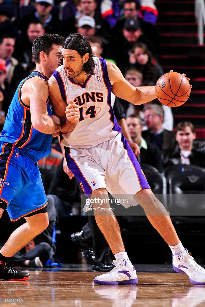 Luis Scola #14 of the Phoenix Suns posts-up against Nick Collison #4 of the Oklahoma City Thunder on January 14, 2013 at U.S. Airways Center in Phoenix, Arizona.