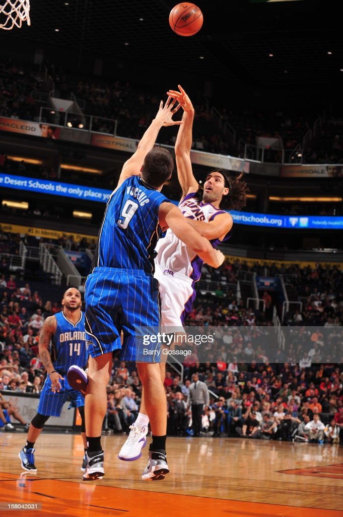 Luis Scola #14 of the Phoenix Suns puts a shot up over Nikola Vucevic #9 of the Orlando Magic on December 9, 2012 at U.S. Airways Center in Phoenix, Arizona.