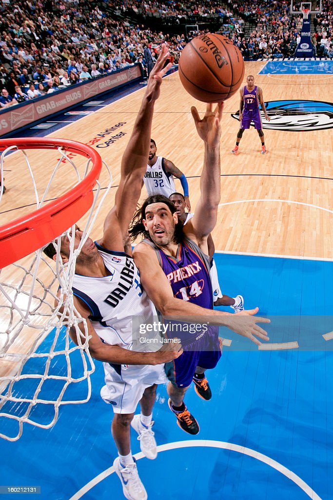 Luis Scola #14 of the Phoenix Suns puts up a hook shot against Brandan Wright #34 of the Dallas Mavericks on January 27, 2013 at the American Airlines Center in Dallas, Texas.