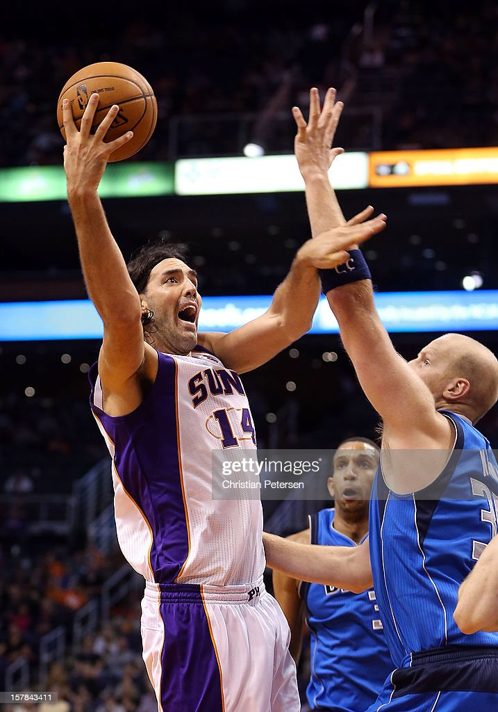 <a gi-track='captionPersonalityLinkClicked' href=/galleries/search?phrase=Luis+Scola&family=editorial&specificpeople=2464749 ng-click='$event.stopPropagation()'>Luis Scola</a> #14 of the Phoenix Suns puts up a shot over <a gi-track='captionPersonalityLinkClicked' href=/galleries/search?phrase=Chris+Kaman&family=editorial&specificpeople=201661 ng-click='$event.stopPropagation()'>Chris Kaman</a> #35 of the Dallas Mavericks during the NBA game at US Airways Center on December 6, 2012 in Phoenix, Arizona. The Mavericks defeated the Suns 97-94.
