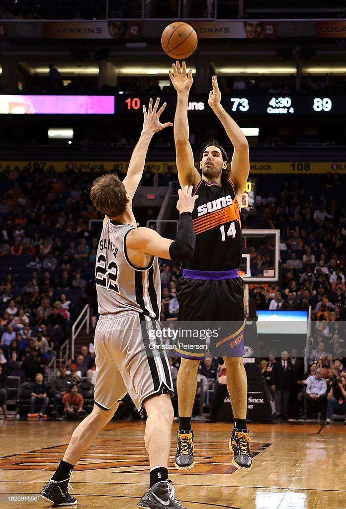 <a gi-track='captionPersonalityLinkClicked' href=/galleries/search?phrase=Luis+Scola&family=editorial&specificpeople=2464749 ng-click='$event.stopPropagation()'>Luis Scola</a> #14 of the Phoenix Suns puts up a shot over <a gi-track='captionPersonalityLinkClicked' href=/galleries/search?phrase=Tiago+Splitter&family=editorial&specificpeople=208218 ng-click='$event.stopPropagation()'>Tiago Splitter</a> #22 of the San Antonio Spurs during the NBA game at US Airways Center on February 24, 2013 in Phoenix, Arizona. The Spurs defeated the Suns 97-87.