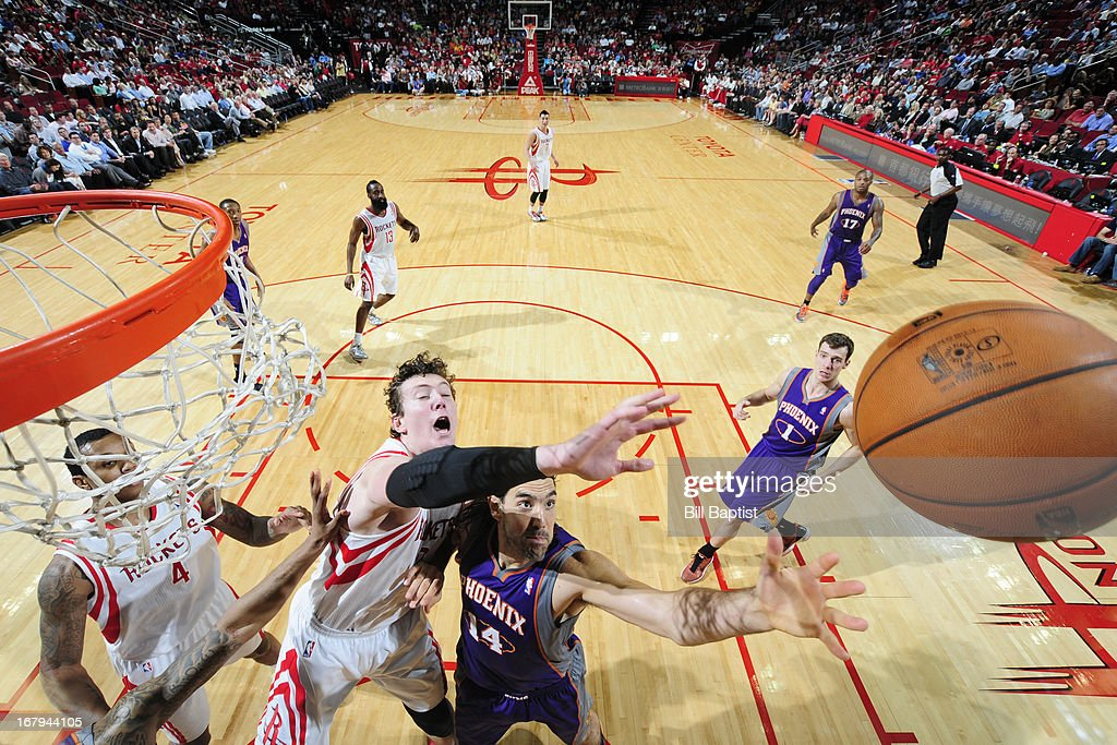 <a gi-track='captionPersonalityLinkClicked' href=/galleries/search?phrase=Luis+Scola&family=editorial&specificpeople=2464749 ng-click='$event.stopPropagation()'>Luis Scola</a> #14 of the Phoenix Suns reaches for a rebound against <a gi-track='captionPersonalityLinkClicked' href=/galleries/search?phrase=Omer+Asik&family=editorial&specificpeople=4946055 ng-click='$event.stopPropagation()'>Omer Asik</a> #3 of the Houston Rockets on April 9, 2013 at the Toyota Center in Houston, Texas.