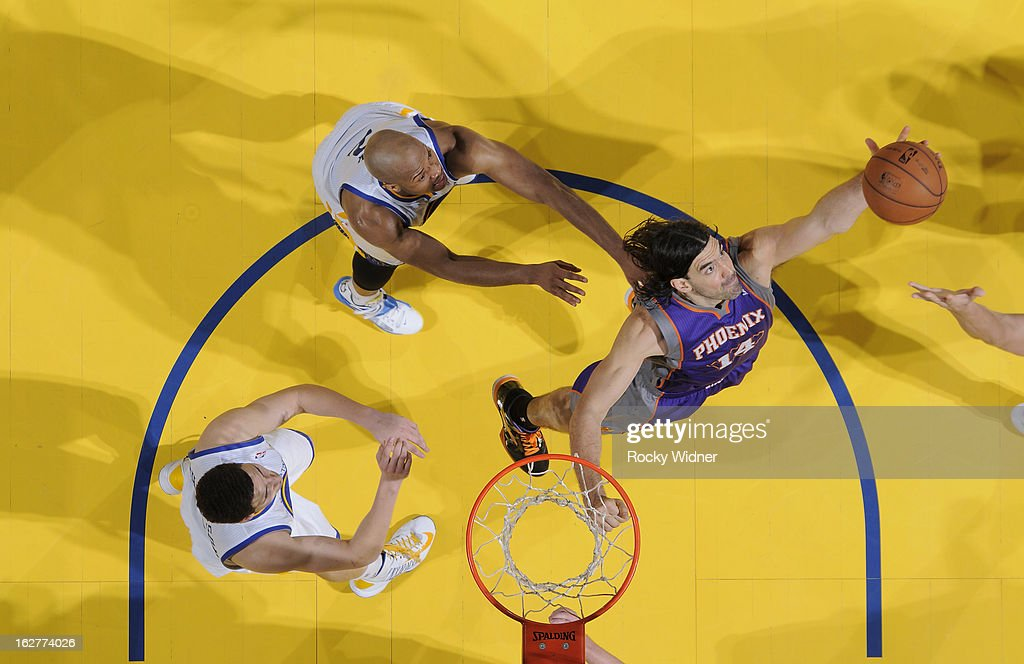 Luis Scola #14 of the Phoenix Suns rebounds against the Golden State Warriors on February 20, 2013 at Oracle Arena in Oakland, California.