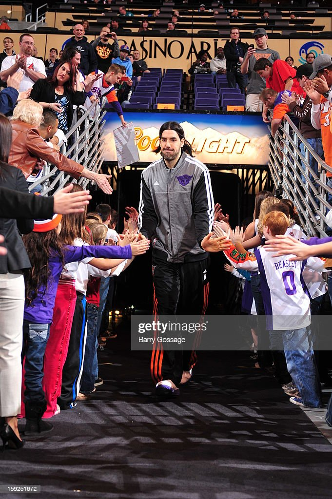 Luis Scola #14 of the Phoenix Suns runs out before the game against the Utah Jazz on January 4, 2013 at U.S. Airways Center in Phoenix, Arizona.