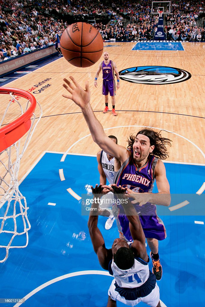 Luis Scola #14 of the Phoenix Suns shoots a layup against Darren Collison #4 of the Dallas Mavericks on January 27, 2013 at the American Airlines Center in Dallas, Texas.
