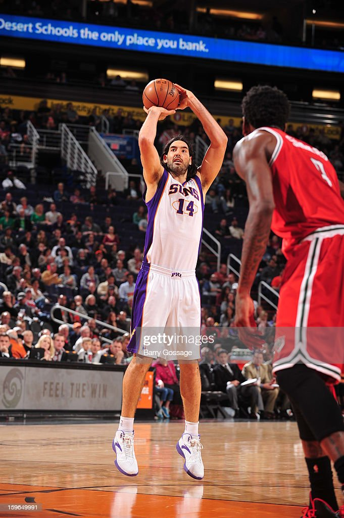 Luis Scola #14 of the Phoenix Suns shoots a short shot against the Milwaukee Bucks on January 17, 2013 at U.S. Airways Center in Phoenix, Arizona.