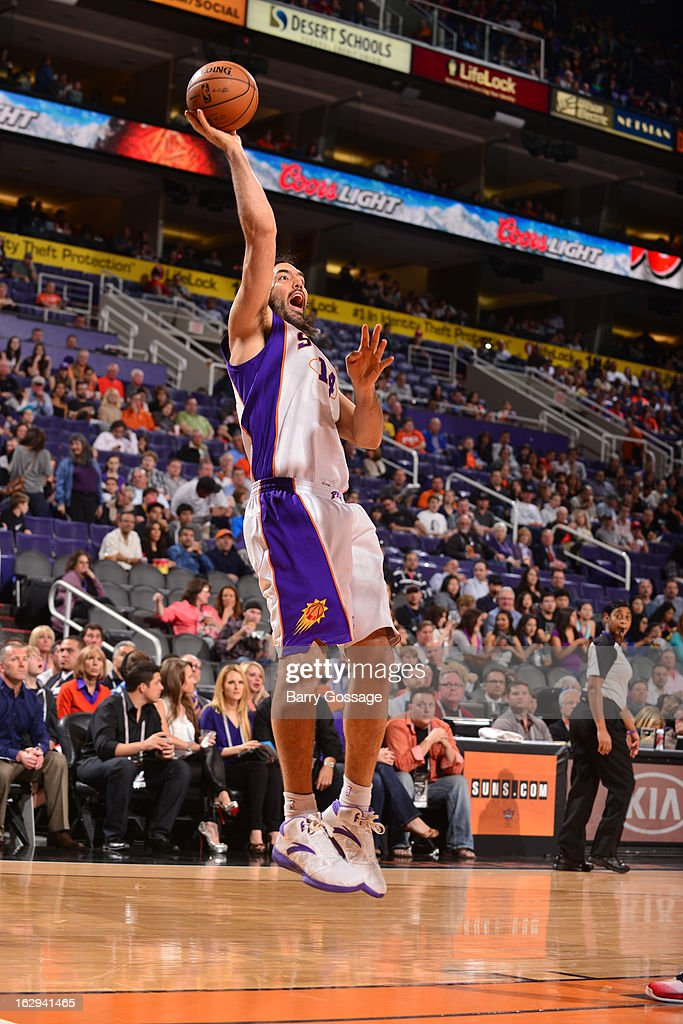 Luis Scola #14 of the Phoenix Suns shoots against the Atlanta Hawks on March 1, 2013 at U.S. Airways Center in Phoenix, Arizona.