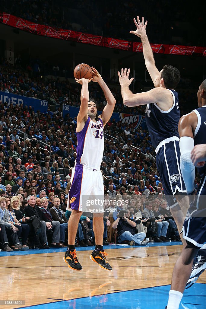 <a gi-track='captionPersonalityLinkClicked' href=/galleries/search?phrase=Luis+Scola&family=editorial&specificpeople=2464749 ng-click='$event.stopPropagation()'>Luis Scola</a> #14 of the Phoenix Suns shoots over the Oklahoma City Thunder during an NBA game on December 31, 2012 at the Chesapeake Energy Arena in Oklahoma City, Oklahoma.