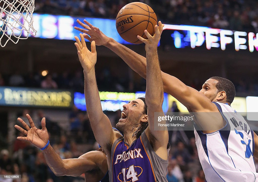 Luis Scola #14 of the Phoenix Suns takes a shot against Brandan Wright #34 of the Dallas Mavericks at American Airlines Center on January 27, 2013 in Dallas, Texas.