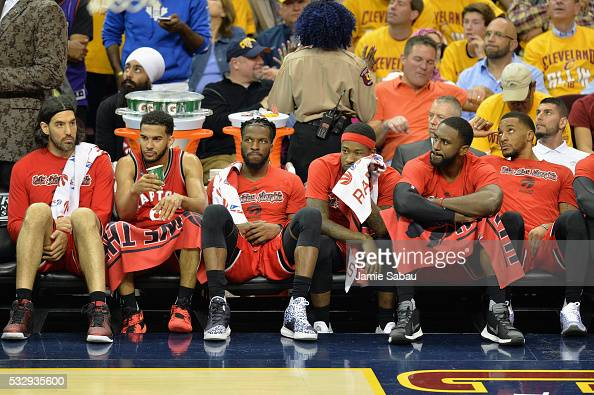 Luis Scola of the Toronto Raptors Cory Joseph DeMarre Carroll Terrence Ross Patrick Patterson and Norman Powell react on the bench during the second...