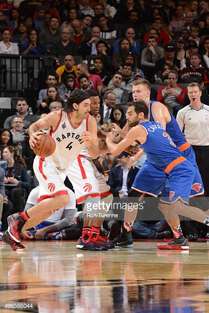 Luis Scola of the Toronto Raptors drives to the basket against the New York Knicks during the game on November 10 2015 at Air Canada Centre in...