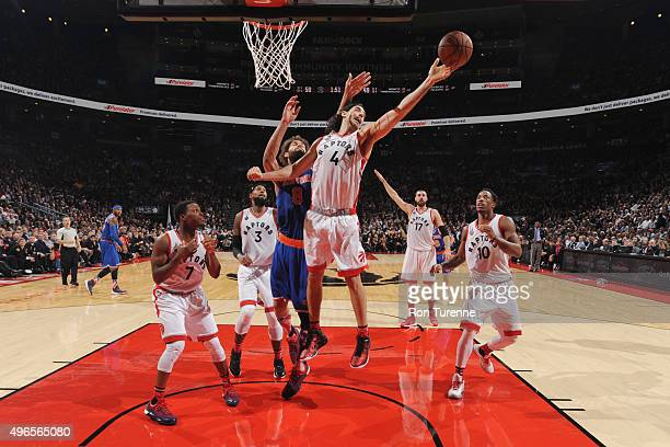Luis Scola of the Toronto Raptors reaches for the rebound against the New York Knicks during the game on November 10 2015 at Air Canada Centre in...
