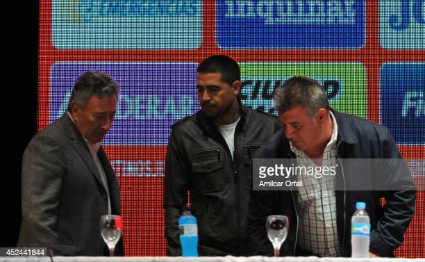 Luis Segura President of Argentinos Jrs Juan Roman Riquelme of Argentinos Jrs and Claudio Borghi coach of Argentinos Jrs prior a press conference...
