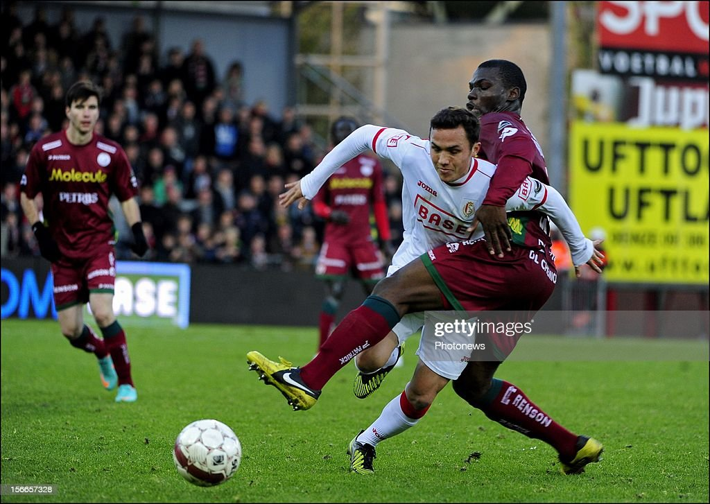 Luis Seijas of Standard Liege and Bernard Malanda-Adje (SV Zulte Waregem) during the Jupiler League match between Zulte - Waregem and Standard of Liege on November 18, 2012 in Waregem , Belgium.