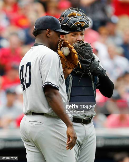 Luis Severino and Austin Romine of the New York Yankees meet at the mound in the fourth inning against the Cleveland Indians at Progressive Field on...
