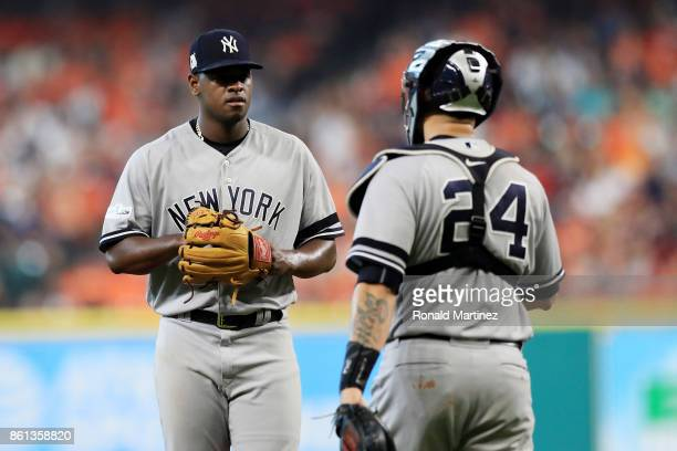 Luis Severino and Gary Sanchez of the New York Yankees meet on the mound in the second inning against the Houston Astros during game two of the...