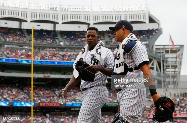 Luis Severino and Gary Sanchez of the New York Yankees prepare for a game against the Boston Red Sox at Yankee Stadium on August 12 2017 in the Bronx...
