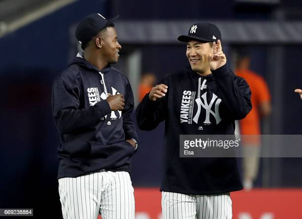 Luis Severino and Masahiro Tanaka of the New York Yankees walk in from the bullpen before the game against the St Louis Cardinals on April 16 2017 at...