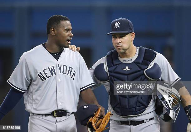 Luis Severino of the New York Yankees and Gary Sanchez talk as they make their way from the bullpen to the dugout before the start of MLB game action...