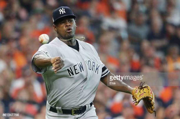 Luis Severino of the New York Yankees fields a groundball by Marwin Gonzalez of the Houston Astros to first for the final out in the first inning...