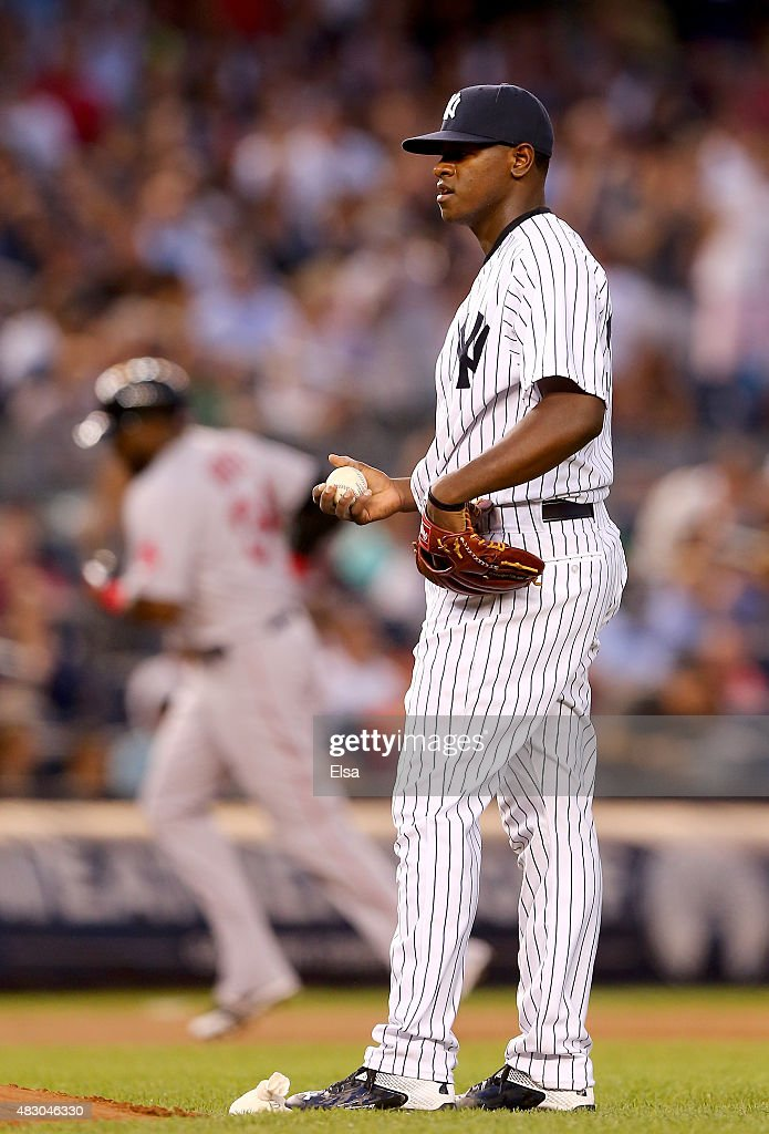 Luis Severino #40 of the New York Yankees reacts as David Ortiz #34 of the Boston Red Sox rounds third base after a solo home run in the fourth inning on August 5, 2015 at Yankee Stadium in the Bronx borough of New York City.This is Severino's Major League debut.