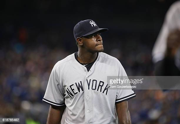 Luis Severino of the New York Yankees walks off the mound at the end of the first inning during MLB game action against the Toronto Blue Jays on...