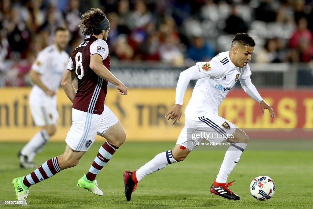 Luis Silva #20 of Real Salt Lake advances the ball agaist Dillon Powers #8 of the Colorado Rapids at Dick's Sporting Goods Park on April 15, 2017 in Commerce City, Colorado.