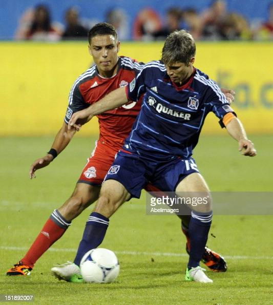 Luis Silva of Toronto FC battles for the ball with Logan Pause of the Chicago Fire during MLS action at the BMO Field September 12 2012 in Toronto...