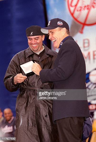 Luis Sojo and Mayor Rudolph Giuliani during Ticker Tape Parade for the New York Yankees 2000 World Series Champions at City Hall in New York NY...