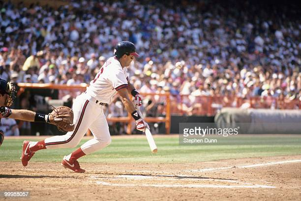Luis Sojo of the California Angels bunts during the game against the Baltimore Orioles at Anaheim Stadium on May 5 1991 in Anaheim California