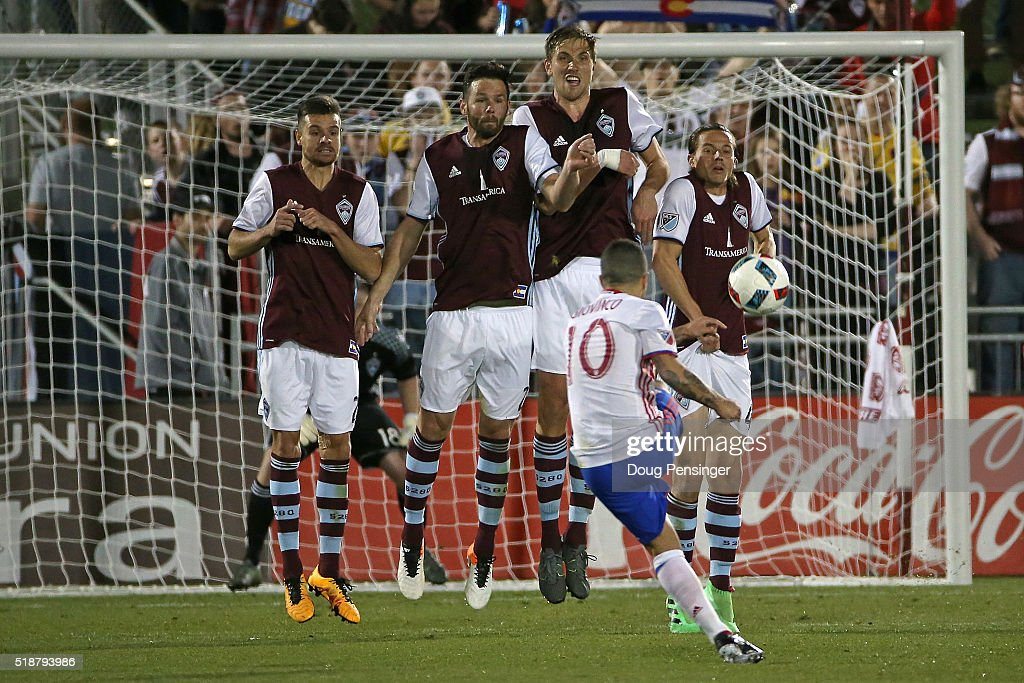 Luis Solignac #21, Bobby Burling #23, Axel Sjoberg #44 and Marc Burch #4 of Colorado Rapids defend against a free kick by <a gi-track='captionPersonalityLinkClicked' href=/galleries/search?phrase=Sebastian+Giovinco&family=editorial&specificpeople=4284715 ng-click='$event.stopPropagation()'>Sebastian Giovinco</a> #10 of Toronto FC at Dick's Sporting Goods Park on April 2, 2016 in Commerce City, Colorado. The Rapids defeated Toronto FC