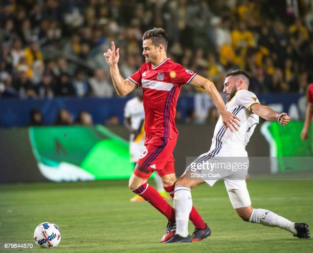 Luis Solignac of Chicago Fire battles Romain Alessandrini of Los Angeles Galaxy during Los Angeles Galaxy's MLS match against Chicago Fire at the...