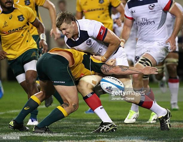 Luis Stanfill of the United States Eagles fumbles the ball as he is hit by Sean McMahon of the Australia Wallabies during a match at Soldier Field on...