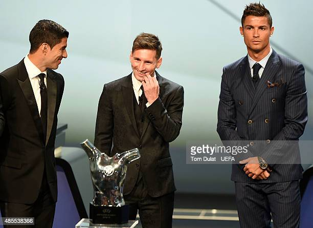 Luis Suarez and Cristiano Ronaldo watch Lionel Messi win the UEFA Best Player in Europe Award during the UEFA Champions League Draw held at Grimaldi...