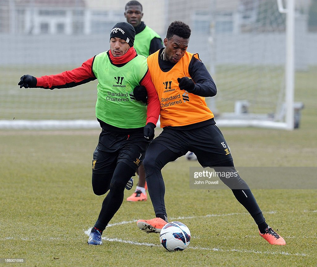 Luis Suarez and <a gi-track='captionPersonalityLinkClicked' href=/galleries/search?phrase=Daniel+Sturridge+-+Soccer+Player&family=editorial&specificpeople=677270 ng-click='$event.stopPropagation()'>Daniel Sturridge</a> of Liverpool in action during a training session at Melwood Training Ground on April 11, 2013 in Liverpool, England.