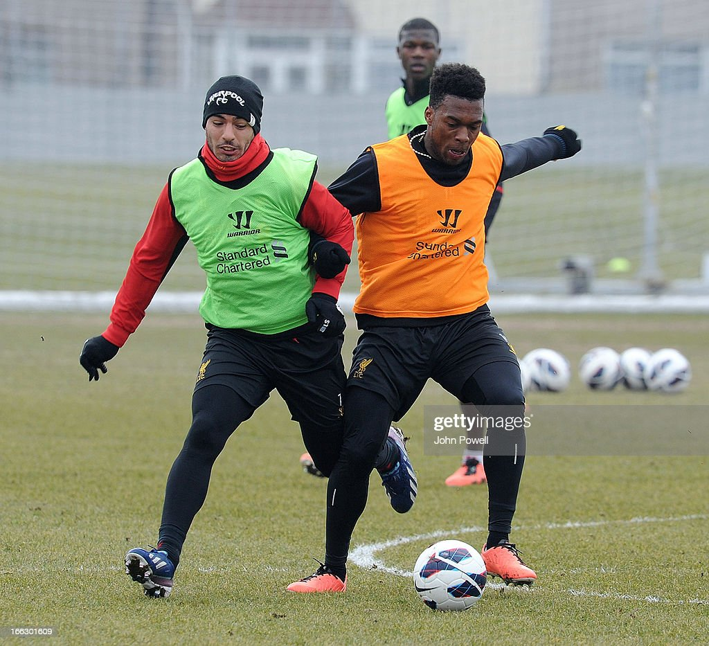 Luis Suarez and Daniel Sturridge of Liverpool in action during a training session at Melwood Training Ground on April 11, 2013 in Liverpool, England.