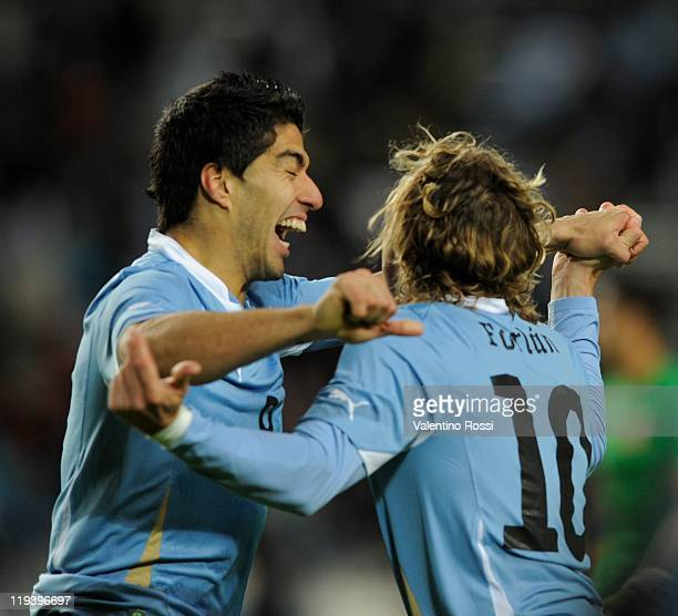 Luis Suarez and Diego Forlagn celebrate the second goal of Uruguay during 2011 Copa America soccer match as part of semifinal at the Ciudad de La...